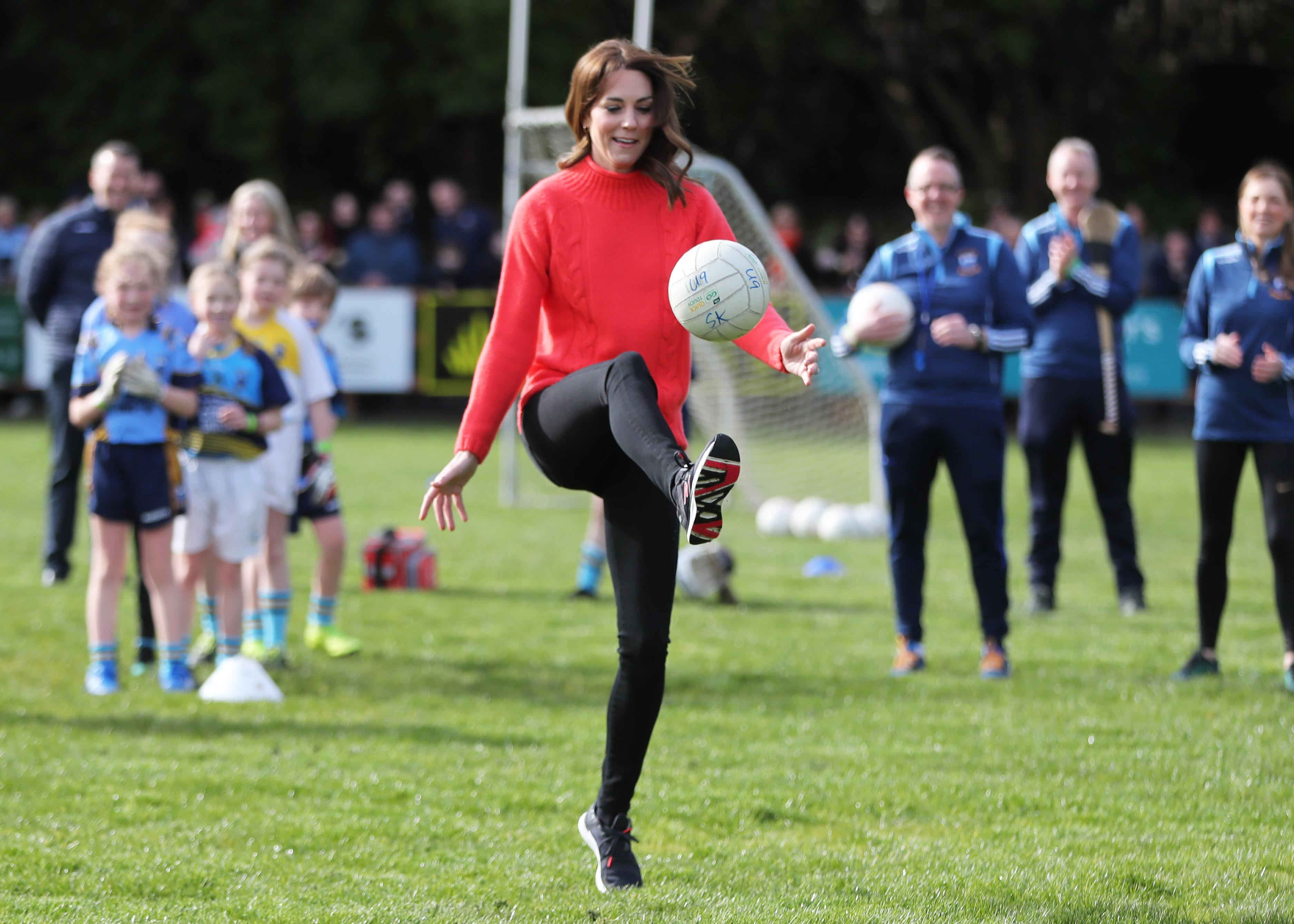 The Duchess of Cambridge playing Gaelic football at Salthill Knocknacarra GAA Club in Galway, where she is visiting with the Duke of Cambridge to learn more about traditional sports during the third day of their visit to the Republic of Ireland. PA Photo. Picture date: Thursday March 5, 2020. See PA story ROYAL Cambridge. Photo credit should read: Niall Carson/PA Wire