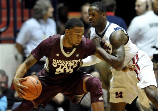 Mississippi State's Arnett Moultrie (23) backs down Mississippi's Murphy Holloway (31) during an NCAA college basketball game in Oxford, Miss., Wednesday, Jan. 18, 2012. (AP Photo/The Oxford Eagle, Bruce Newman) NO SALES MAGS OUT MANDATORY CREDIT