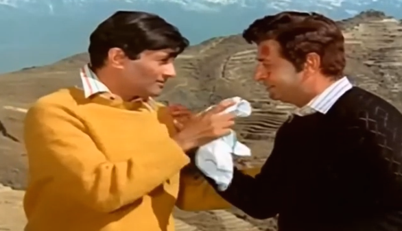 As Dev Anand's long-lost brother Moti / Mohan, Pran built a relatable persona around his archetypal bad guy character.