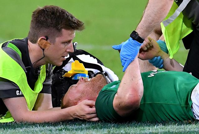 Rugby Union - June Internationals - Australia vs Ireland - Lang Park, Brisbane, Australia - June 9, 2018 - Keith Earls of Ireland as assisted by medical staff as he lies on the ground after being injured. AAP/Darren England/via REUTERS ATTENTION EDITORS - THIS IMAGE WAS PROVIDED BY A THIRD PARTY. NO RESALES. NO ARCHIVE. AUSTRALIA OUT. NEW ZEALAND OUT.