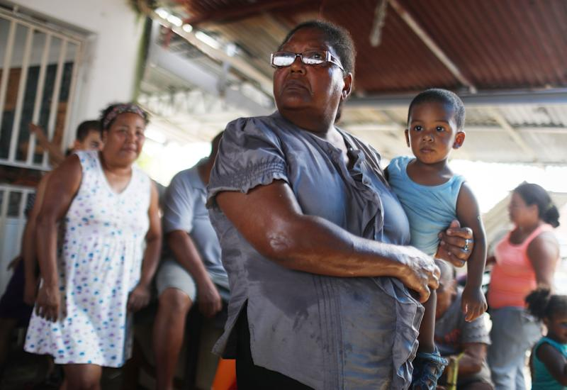Americans in San Isidro, Puerto Rico, wait for FEMA to arrive with water. Their neighborhood has been without power or clean water for more than a month.