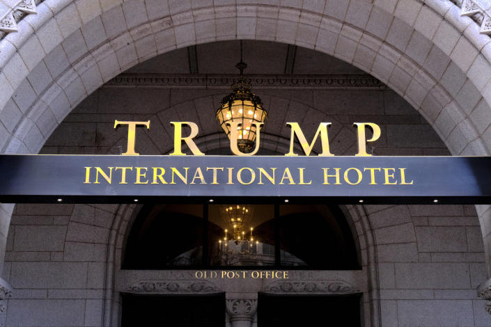 FILE- This March 11, 2019 file photo, shows the north entrance of the Trump International in Washington D.C. A federal appeals court has ordered the dismissal of a lawsuit accusing President Donald Trump of illegally profiting off the presidency. In a significant legal victory for Trump, a three-judge panel of the 4th U.S. Circuit Court of Appeals on Wednesday, July 10, 2019, overturned a ruling by a federal judge in Maryland who ruled last year that the lawsuit could move forward. (AP Photo/Mark Tenally, File)