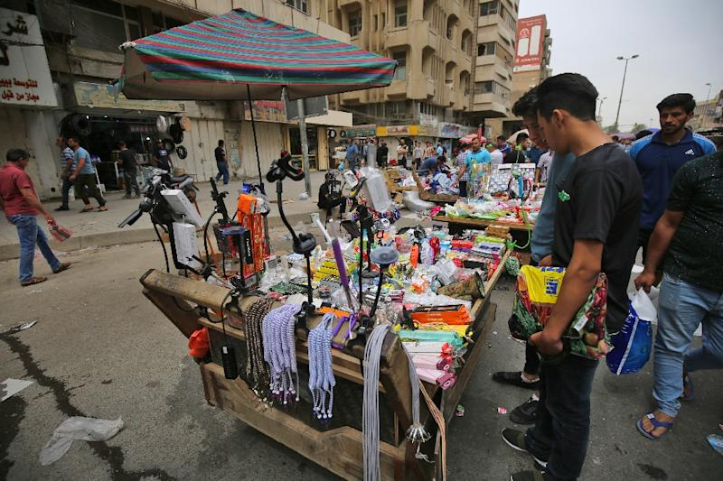 Iraqi street vendors display their products in Baghdad, where the population have swelled from 4.7 million in 2003 to 7.2 million inhabitants in 2018 (AFP Photo/AHMAD AL-RUBAYE)