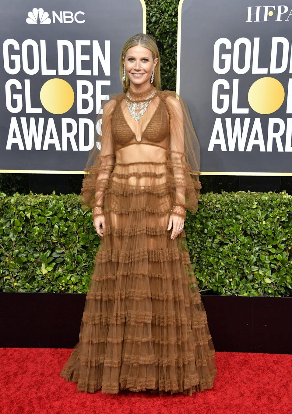 """<p><a class=""""link rapid-noclick-resp"""" href=""""https://www.popsugar.com/Gwyneth-Paltrow"""" rel=""""nofollow noopener"""" target=""""_blank"""" data-ylk=""""slk:Gwyneth Paltrow"""">Gwyneth Paltrow</a> revealed her lingerie underneath her sheer, ruffled Fendi maxi gown at the 2020 Golden Globes. Rather than layering her statement necklace over the high neckline, Gwyneth accessorized in a subtler way, a style move we're not used to seeing but one that might have been suggested by her stylist, Elizabeth Saltzman.</p>"""