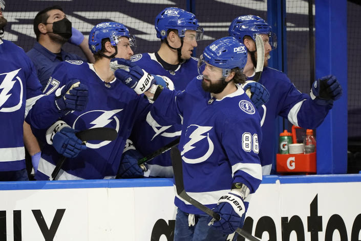 Tampa Bay Lightning right wing Nikita Kucherov (86) celebrates his goal against the Florida Panthers with the bench during the third period in Game 4 of an NHL hockey Stanley Cup first-round playoff series Saturday, May 22, 2021, in Tampa, Fla. (AP Photo/Chris O'Meara)