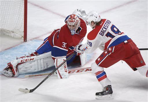 Montreal Canadiens goaltender Carey Price makes a save against Washington Capitals' Nicklas Backstrom during the second period of an NHL hockey game in Montreal, Saturday, April 20, 2013. (AP Photo/The Canadian Press, Graham Hughes)