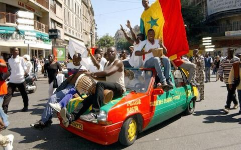 Senegal fans are a colourful bunch - Credit: ap