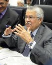Saudi Arabia's Minister of Petroleum and Mineral Resources Ali Ibrahim Naimi talks to journalists prior to the start of a meeting of the Organization of the Petroleum Exporting Countries, OPEC, at their headquarters in Vienna, Austria, Friday, May. 31, 2013. (AP Photo/Hans Punz)