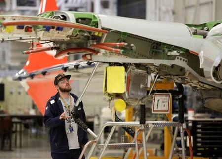 FILE PHOTO -  A Boeing worker is pictured in the wing system installation area at their factory in Renton, Washington