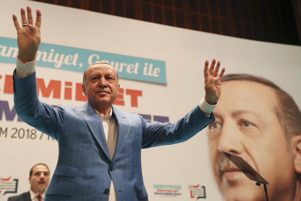 """Turkey's President Recep Tayyip Erdogan waves during a rally in Kizilcahamam, central Turkey on Sunday. Asked by journalists about Saudi writer Jamal Khashoggi, who vanished Tuesday while on a visit to the Saudi Consulate, Erdogan said, """"God willing, we will not be faced with the situation we do not desire."""" (Photo: Presidential Press Service via AP, pool)"""