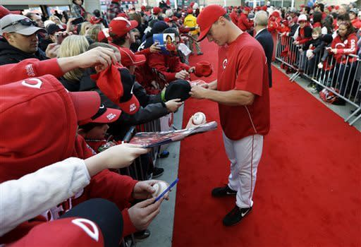 Cincinnati Reds' Jay Bruce signs autographs on the red carpet before a baseball game against the Los Angeles Angels, Wednesday, April 3, 2013, in Cincinnati. (AP Photo/Al Behrman)