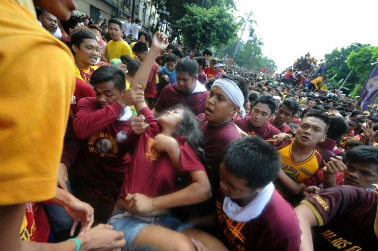 Hundreds were injured during the religious gathering as shoeless devotees hurled themselves at a statue of Jesus believed to have healing powers