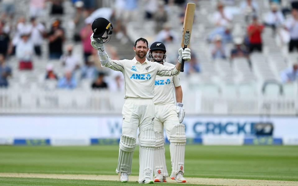 Devon Conway of New Zealand celebrates reaching his century with Henry Nicholls during Day 1 of the First LV= Insurance Test Match between England and New Zealand at Lord's Cricket Ground on June 02, 2021 in London, England - Gareth Copley - ECB/ECB