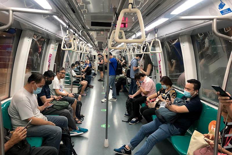 People in face masks seen on a East-West line MRT train on 12 May 2020. (PHOTO: Dhany Osman / Yahoo News Singapore)