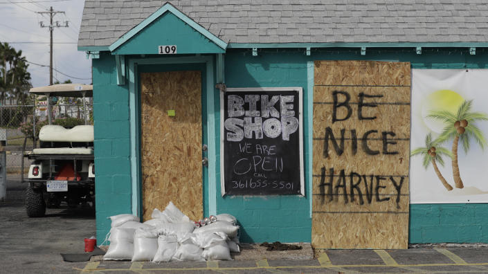 """<p>A sign reading """"Be Nice Harvey"""" was left behind on a boarded up business, Thursday, Aug. 24, 2017, in Port Aransas, Texas. (Photo: Eric Gay/AP) </p>"""