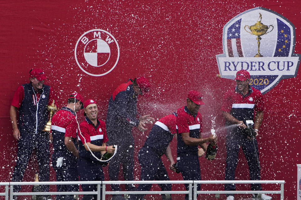 Team USA celebrates at the closing ceremony after winning the Ryder Cup at the Whistling Straits Golf Course Sunday, Sept. 26, 2021, in Sheboygan, Wis. (AP Photo/Jeff Roberson)
