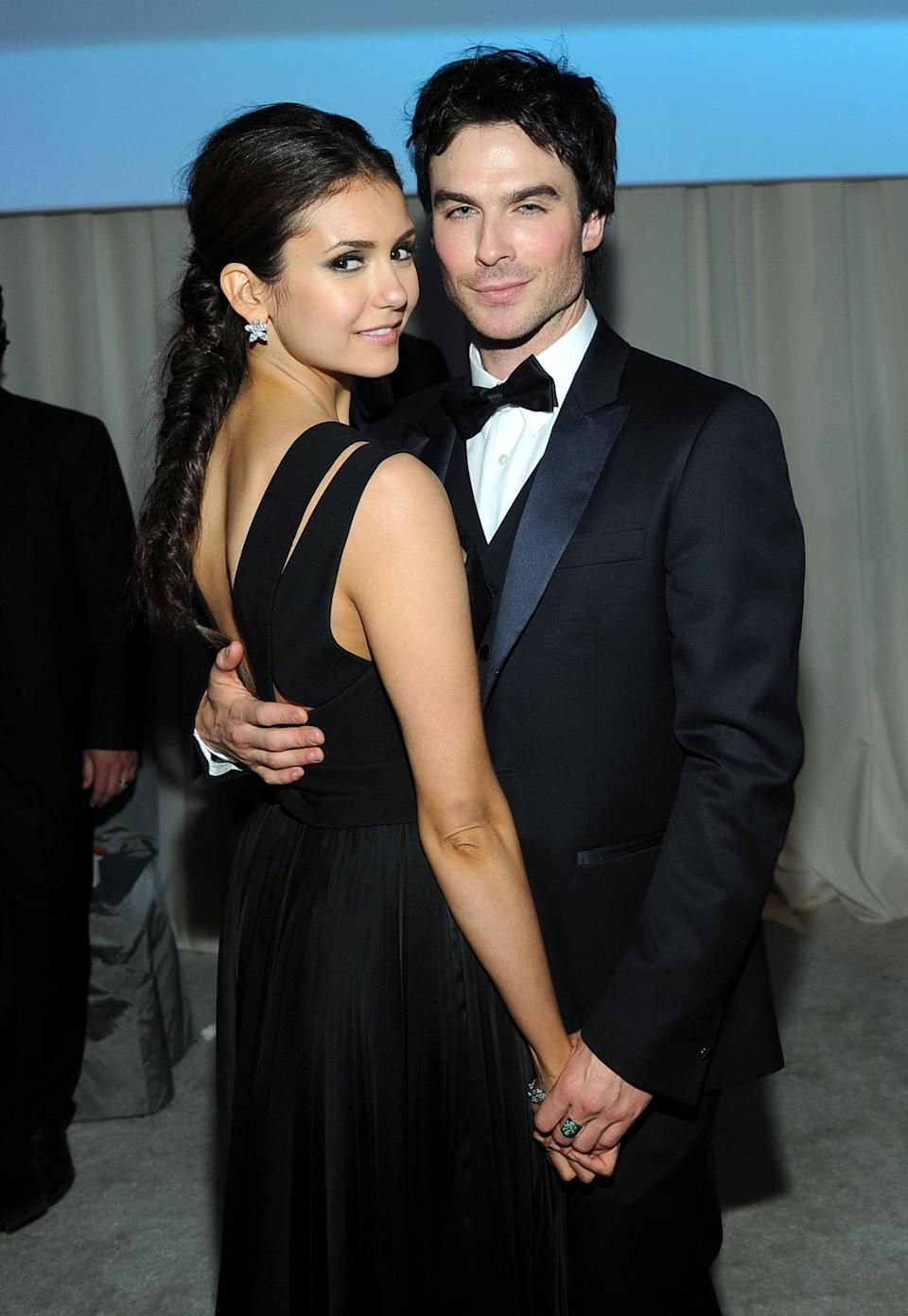 """<p>Nina and Ian met on the set of <strong>Vampire Diaries </strong>in 2009 - where they played on-and-off lovers Damon and Elena - and it wasn't long before the two started dating IRL. After their breakup in 2013, both actors remained on the series until its finale in 2017 (though in 2015, Nina went from a main cast member to a guest on the series).</p> <p>Even now, <a href=""""http://www.eonline.com/news/655943/nina-dobrev-breaks-silence-on-ian-somerhalder-s-beautiful-wedding"""" class=""""link rapid-noclick-resp"""" rel=""""nofollow noopener"""" target=""""_blank"""" data-ylk=""""slk:the actors remain close friends"""">the actors remain close friends</a>. As Nina told <strong>E! News</strong> in May 2015, """"I've said this before, that we didn't break up because anything bad happened or because there wasn't love or friendship. I love him and the friendship is still strong and I think he's great and I care about him. And that didn't change. Yes, we're professional and that's fine. We were friends long before we dated and we still are now.""""</p> <p><a href=""""http://www.eonline.com/news/498049/nina-dobrev-talks-people-s-choice-moment-with-ian-somerhalder-it-was-just-honest"""" class=""""link rapid-noclick-resp"""" rel=""""nofollow noopener"""" target=""""_blank"""" data-ylk=""""slk:The two even hilariously addressed their split"""">The two even hilariously addressed their split</a> onstage after winning the best chemistry award at the 2014 People's Choice Awards. Of the moment, Nina told <strong>E! News</strong>, """"I was trying to figure out, like what do you say in that situation? We were like, well, we're cool, we're friends and costars. He's a great person, I'm a great person . . . I mean, I think I'm pretty awesome. So it doesn't need to be awkward and I think everyone expected it to be so awkward. We made fun of ourselves and just had fun.""""</p>"""