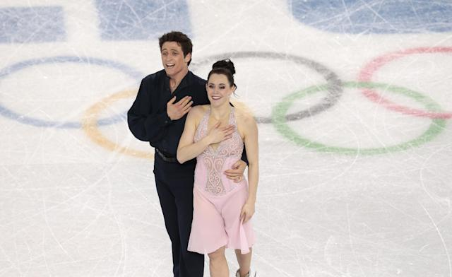Tessa Virtue and Scott Moir of Canada complete their routine in the ice dance free dance figure skating finals at the Iceberg Skating Palace during the 2014 Winter Olympics, Monday, Feb. 17, 2014, in Sochi, Russia. (AP Photo/Ivan Sekretarev)