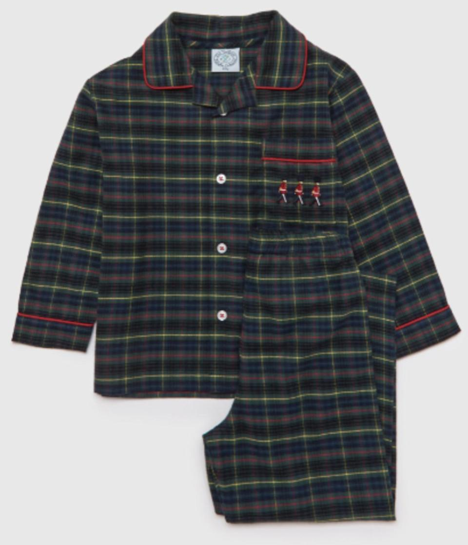 """<p>Follow Prince George's lead in cute and cozy tartan from Trotters. The future monarch wore tartan trousers from the royal-approved brand in official pictures with the Queen last Christmas. Now little ones can get a similar look with these soft, brushed cotton pajamas complete with marching Guardsmen. </p> <p><strong>Buy it! Trotters Guardsman Pyjamas, $68; <a href=""""https://www.trotters.co.uk/products/guardsman-pyjamas?currency=USD"""" rel=""""nofollow noopener"""" target=""""_blank"""" data-ylk=""""slk:trotters.co.uk"""" class=""""link rapid-noclick-resp"""">trotters.co.uk</a></strong></p>"""