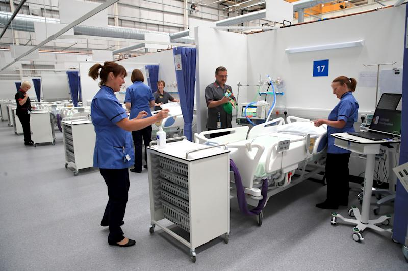 Staff prepare bays at the NHS Nightingale Hospital North East in Sunderland (Photo: Owen Humphreys via Getty Images)