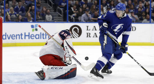 Columbus Blue Jackets goaltender Sergei Bobrovsky (72) makes a save on a shot by Tampa Bay Lightning center Anthony Cirelli (71) during the second period of an NHL hockey game Tuesday, Jan. 8, 2019, in Tampa, Fla. (AP Photo/Chris O'Meara)