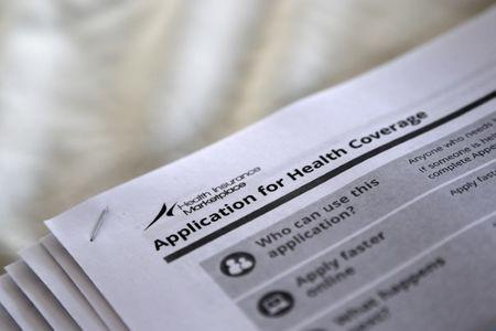 FILE PHOTO - Applications are seen at a rally held by supporters of the Affordable Care Act in Jackson Mississippi