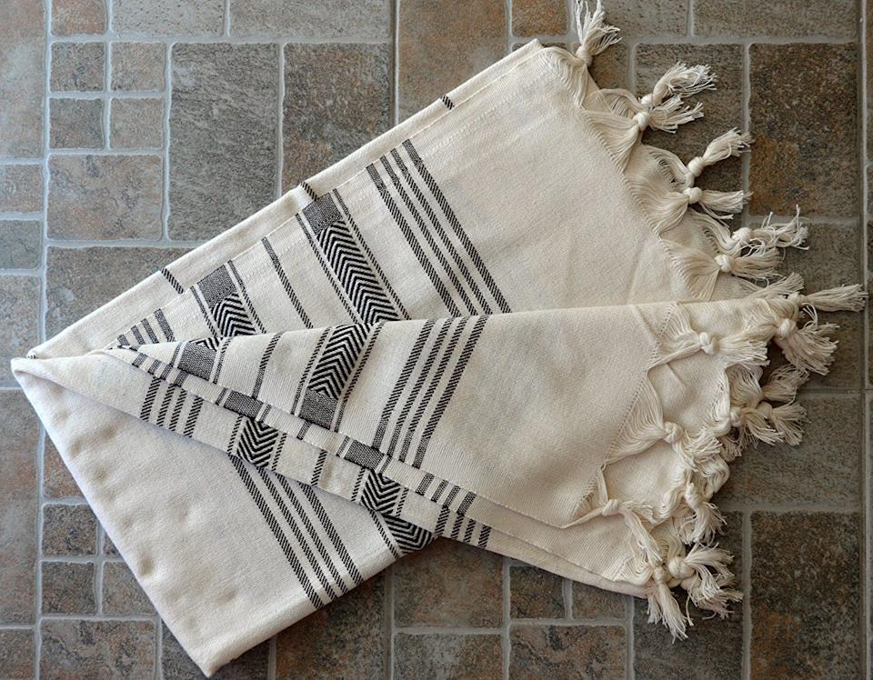 """Travelers know that versatility is key. A Turkish bath towel can be used as a scarf, a beach towel, a coverup, a blanket and, you guessed it, even a towel. <strong><a href=""""https://www.amazon.com/gp/product/B015BFVWVE/?tag=thehuffingtop-20"""" target=""""_blank"""" rel=""""noopener noreferrer"""">Get it here</a></strong>."""