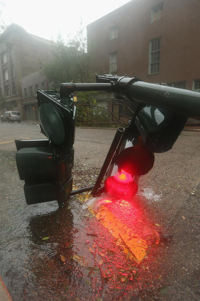 A downed streetlight lies in the rain from Hurricane Isaac in the Central Business District on August 29, 2012 in New Orleans, Louisiana. The large Level 1 hurricane is slowly moving across southeast Louisiana, dumping large amounts of rain and knocking out power to Louisianans in scattered parts of the state. (Photo by Mario Tama/Getty Images)