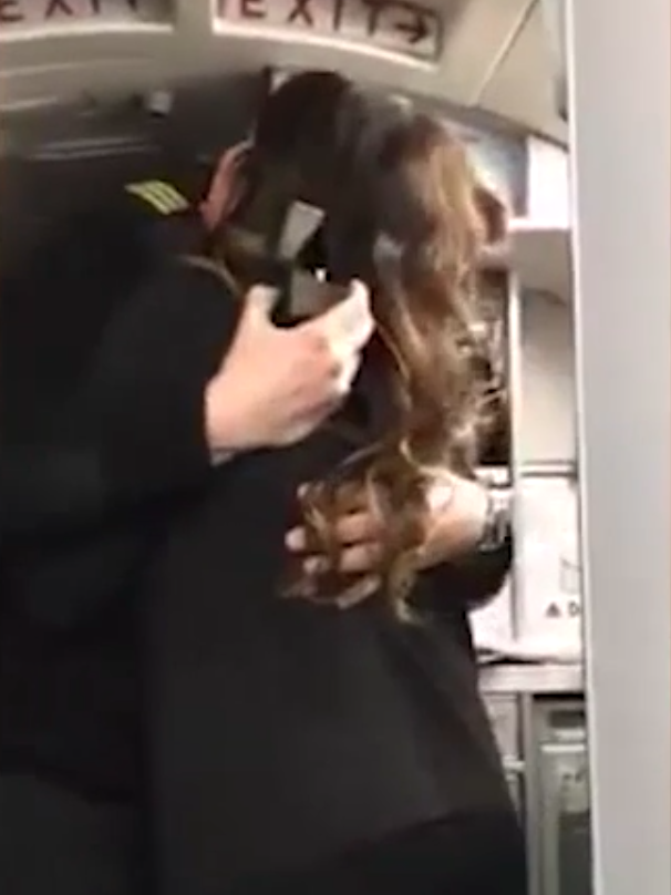 Lauren and Jon have a hug before getting back to work. Source: Storyful