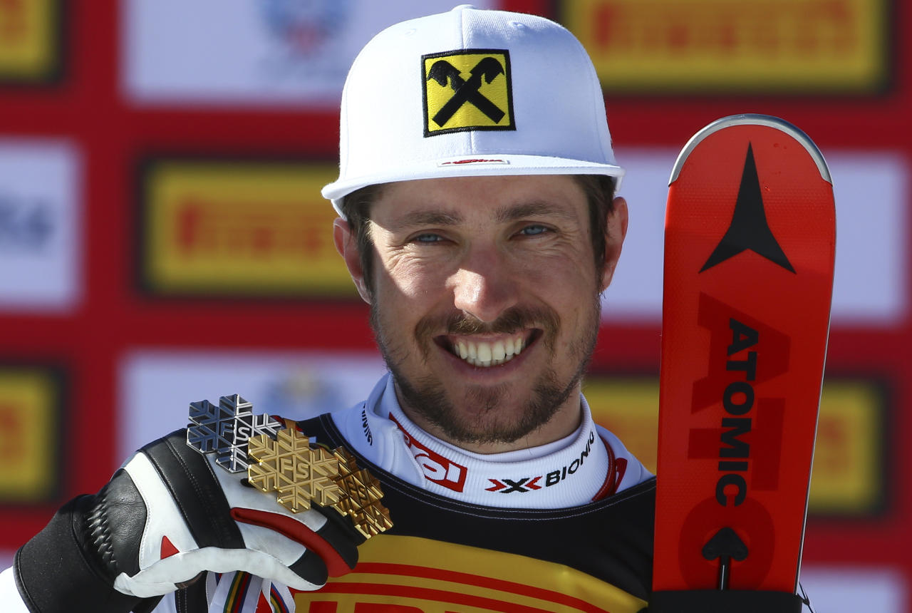 Alpine Skiing - FIS Alpine Skiing World Championships - Men's Special Slalom - St. Moritz, Switzerland - 19/2/17 - Gold medalist Marcel Hirscher of Austria poses with his three St. Moritz medals during the medal ceremony for the men's slalom.      REUTERS/Stefano Rellandini
