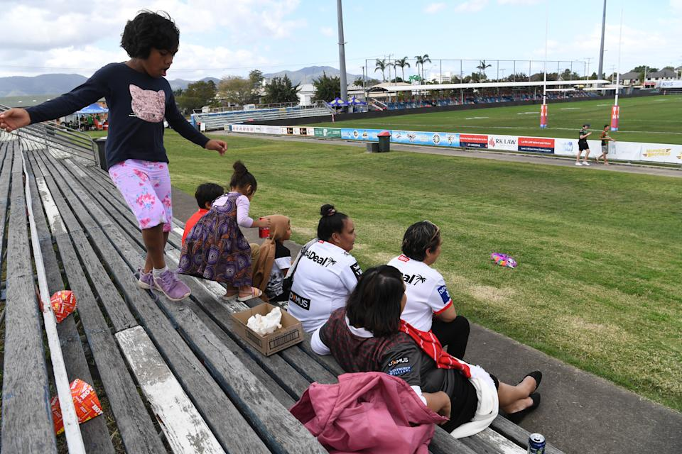 NRL Fans are seen at an empty Browne Park in Rockhampton after the cancellation of the NRL Round 20 match.
