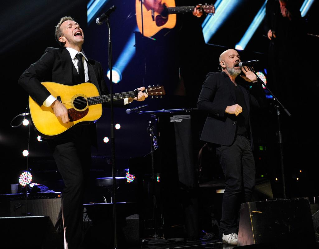 "NEW YORK, NY - DECEMBER 12:  Chris Martin and Michael Stipe perform at ""12-12-12"" a concert benefiting The Robin Hood Relief Fund to aid the victims of Hurricane Sandy presented by Clear Channel Media & Entertainment, The Madison Square Garden Company and The Weinstein Company at Madison Square Garden on December 12, 2012 in New York City.  (Photo by Kevin Mazur/WireImage for Clear Channel)"
