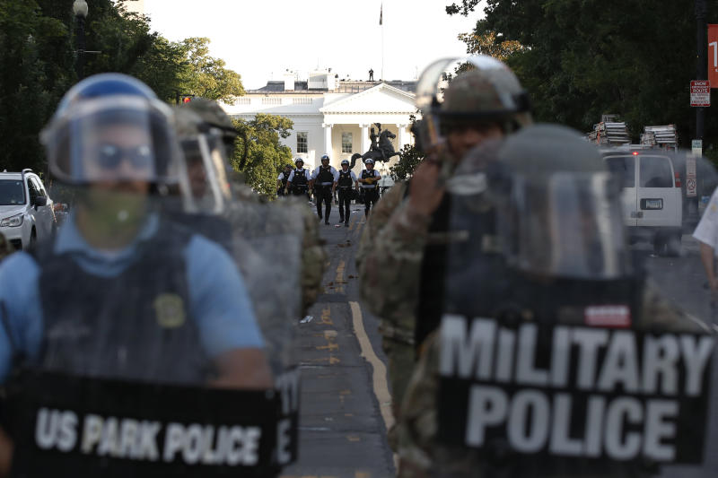 FILE - In this Monday, June 1, 2020, file photo police clear the area around Lafayette Park and the White House in Washington, as demonstrators gather to protest the death of George Floyd, a black man who died after being restrained by Minneapolis police officers last month. The relationship between the nation's military community and the Republican president has been strained repeatedly over the course of Trump's turbulent first term. (AP Photo/Alex Brandon, File)