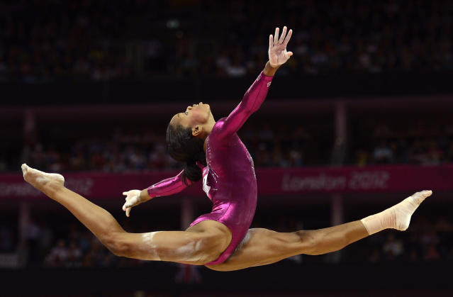 Gabrielle Douglas of the U.S. competes in the balance beam during the women's individual all-around gymnastics final in the North Greenwich Arena during the London 2012 Olympic Games August 2, 2012. REUTERS/Dylan Martinez (BRITAIN - Tags: SPORT OLYMPICS SPORT GYMNASTICS TPX IMAGES OF THE DAY)