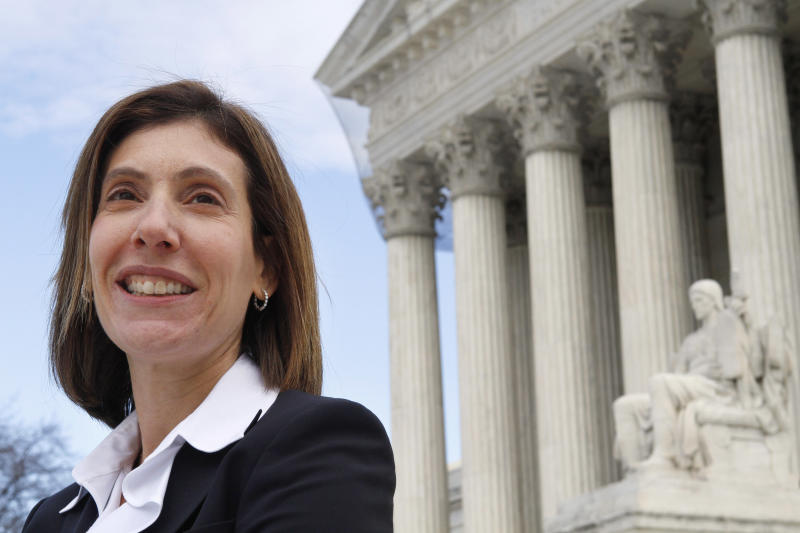 """In this photo taken Jan. 19, 2011, Lisa Blatt is seen outside the U.S. Supreme Court in Washington before making her 30th argument before the court. Now in private practice after years of working for the Department of Justice, Blatt has written that over the years most women arguing at the court have been public-interest lawyers, public defenders or government attorneys. """"Translation: women are doing the same work but for less pay,"""" she wrote. This term, Blatt made three arguments, the only woman in private practice to make more than one. There were 10 men in private practice with multiple arguments. (AP Photo/Jacquelyn Martin)"""