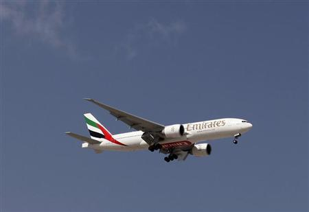 An Emirates Airlines plane lands at the Emirates terminal at Dubai International Airport