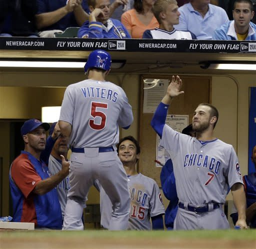 Chicago Cubs' Josh Vitters (5) is greeted by teammates and manager Dale Sveum, left, after his home run against the Milwaukee Brewers during the fifth inning of a baseball game Monday, Aug. 20, 2012, in Milwaukee. (AP Photo/Jeffrey Phelps)