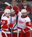 Detroit Red Wings left wing Thomas Vanek, center, is congratulated by right wing Filip Zadina (11) and center Frans Nielsen (51) after Vanek scored during the second period of an NHL hockey game against the Florida Panthers, Sunday, March 10, 2019 in Sunrise, Fla. (AP Photo/Wilfredo Lee)