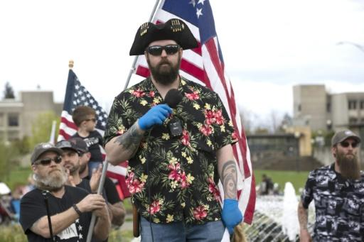 "The ""Boogaloo"" movement (supporters pictured April 2020 in Olympia, Washington), which has adopted Hawaiian shirts as a uniform, promotes ""a coming civil war and/or collapse of society"""