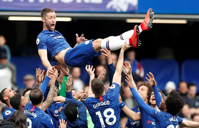 Gary Cahill is thrown in the air by his Chelsea teammates after the Blues beat Watford 3-0 on Sunday, a win that set the stage for their return to the UEFA Champions League. (Matthew Childs/Reuters)