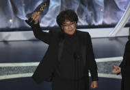 "Bong Joon Ho accepts the award for best international feature film for ""Parasite,"" from South Korea, at the Oscars on Sunday, Feb. 9, 2020, at the Dolby Theatre in Los Angeles. (AP Photo/Chris Pizzello)"