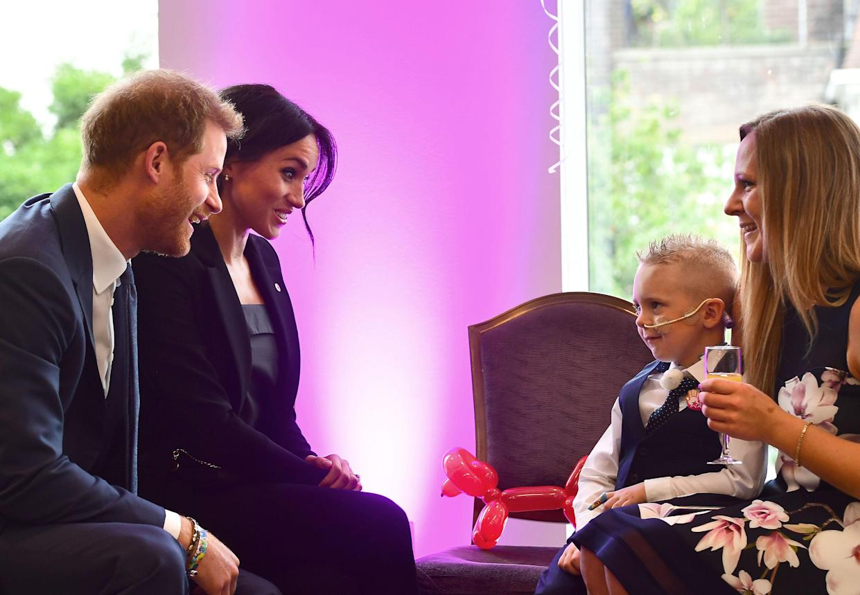 Duke and Duchess of Sussex meet four-year-old McKenzie Brackley ahead of the WellChild Awards [Photo: PA]