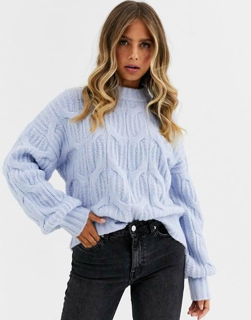 "<p>This <a href=""https://www.popsugar.com/buy/Urban-Bliss-Balloon-Sleeve-Cable-Knit-Sweater-493768?p_name=Urban%20Bliss%20Balloon-Sleeve%20Cable%20Knit%20Sweater&retailer=asos.com&pid=493768&price=48&evar1=fab%3Auk&evar9=46670855&evar98=https%3A%2F%2Fwww.popsugar.com%2Ffashion%2Fphoto-gallery%2F46670855%2Fimage%2F46671402%2FUrban-Bliss-Balloon-Sleeve-Cable-Knit-Sweater&list1=shopping%2Cfall%20fashion%2Csweaters%2C50%20under%20%2450%2Caffordable%20shopping&prop13=api&pdata=1"" rel=""nofollow"" data-shoppable-link=""1"" target=""_blank"" class=""ga-track"" data-ga-category=""Related"" data-ga-label=""https://www.asos.com/us/urban-bliss/urban-bliss-balloon-sleeve-cable-knit-sweater/prd/12773657?clr=laundered-blue&amp;colourWayId=16457786&amp;SearchQuery=&amp;cid=2637"" data-ga-action=""In-Line Links"">Urban Bliss Balloon-Sleeve Cable Knit Sweater </a> ($48) is already selling fast.</p>"