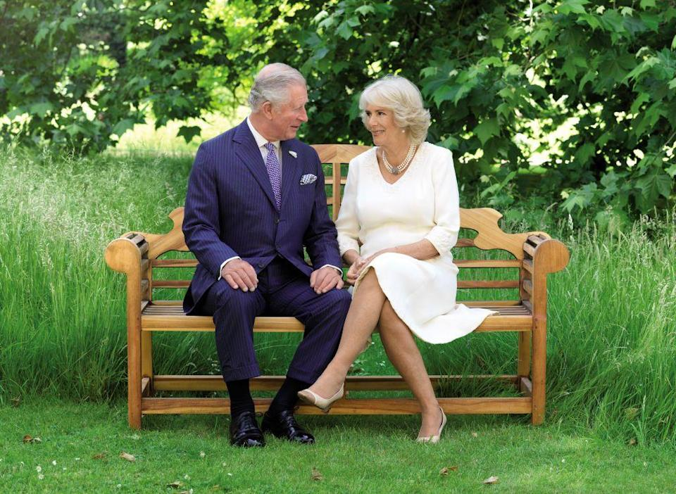 "<p>Prince Charles and <strong><a href=""https://www.goodhousekeeping.com/life/a20721800/why-prince-charles-didnt-marry-camilla-first/"" rel=""nofollow noopener"" target=""_blank"" data-ylk=""slk:Duchess Camilla"" class=""link rapid-noclick-resp"">Duchess Camilla</a></strong> look just as in love as ever for this adoring shot. Photographer Hugo Burnand captured the Christmas card-worthy moment on the grounds of Clarence House.</p>"