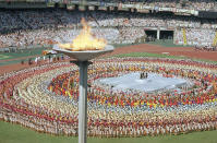 FILE - In this Sept. 17, 1988, file photo, the Olympic cauldron towers above the Olympic stadium in Seoul, South Korea, during the opening ceremonies for the summer Olympic Games. (AP Photo/Mark Duncan, File)