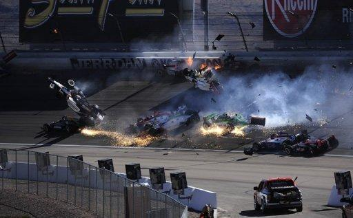 English driver Dan Wheldon was seriously hurt in a massive 15-car crash that sent his and several other cars airborne early in the Las Vegas 300 IndyCar series finale on Sunday