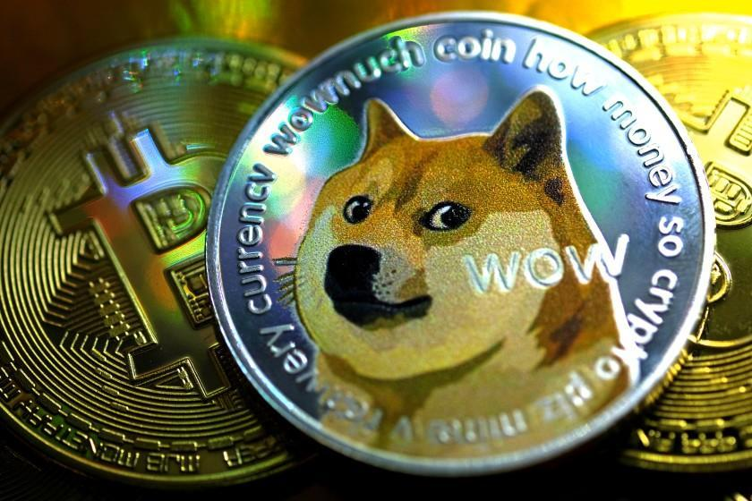 Photo-illustration visual representations of digital cryptocurrencies, Dogecoin and Bitcoin