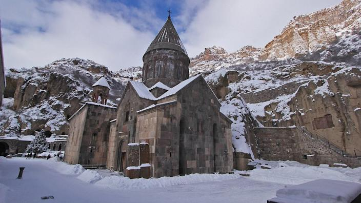The <strong>Monastery of Geghard</strong> in Armenia is known for its medieval churches and tombs, which are built into the cliffs.