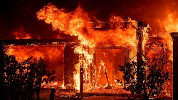 PHOTO: Flames consume a home during the Kincade fire as flames race through Healdsburg, Calif., Oct. 27, 2019. (Josh Edelson/AFP/Getty Images)