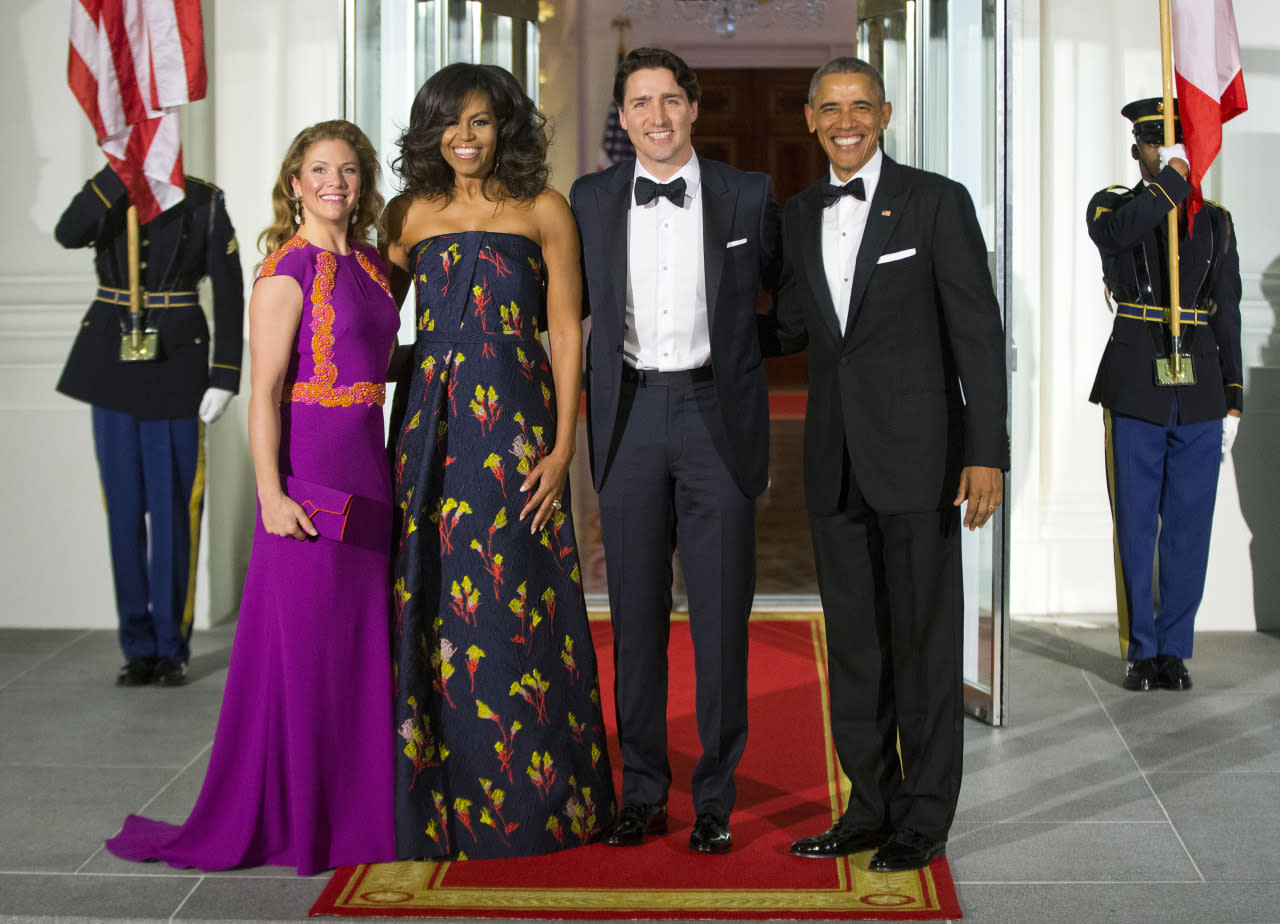 <p>Spring has sprung — at least according to the dresses worn at the state dinner in Washington, D.C., Thursday night. While Michelle Obama called on her old friend Jason Wu for a custom floral gown, her equally stylish Canadian counterpart opted for a bright magenta gown with orange appliqué. Meanwhile, their husbands chose traditional tuxedos. (<i>Photo: AP)</i></p>